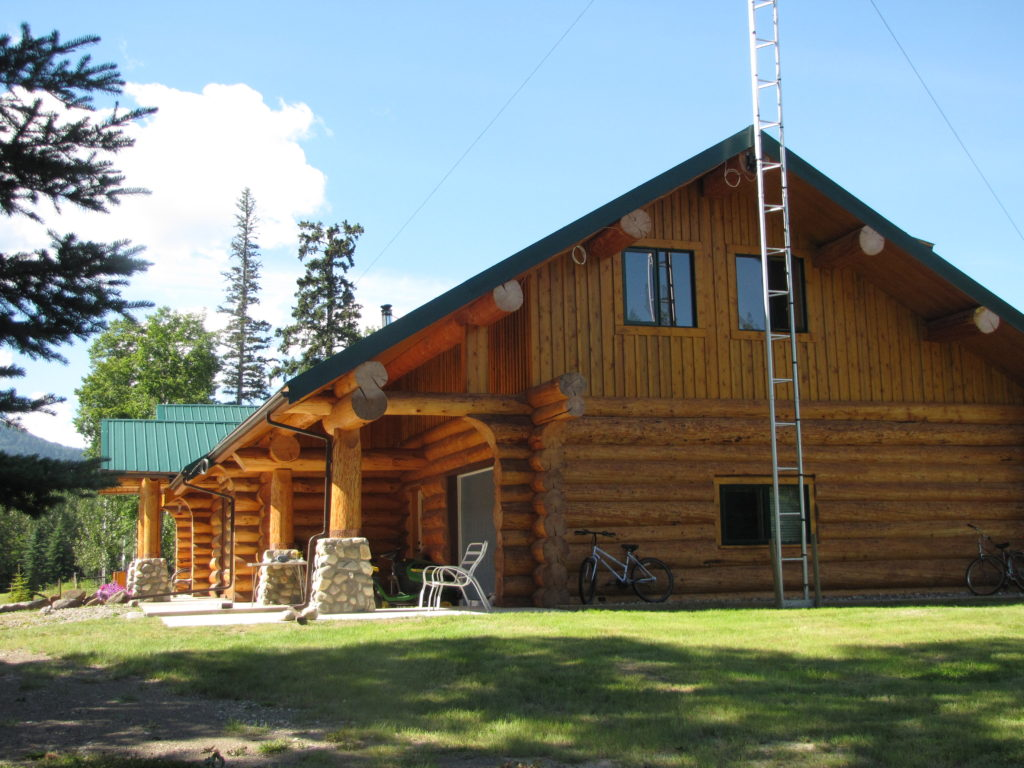 276 Cowie Creek Road >Chetwynd | Wildlife Paradise 126 Forested Acres | Log Home with Rock Fireplace | Garage and Workshop | Log Guest Cabin