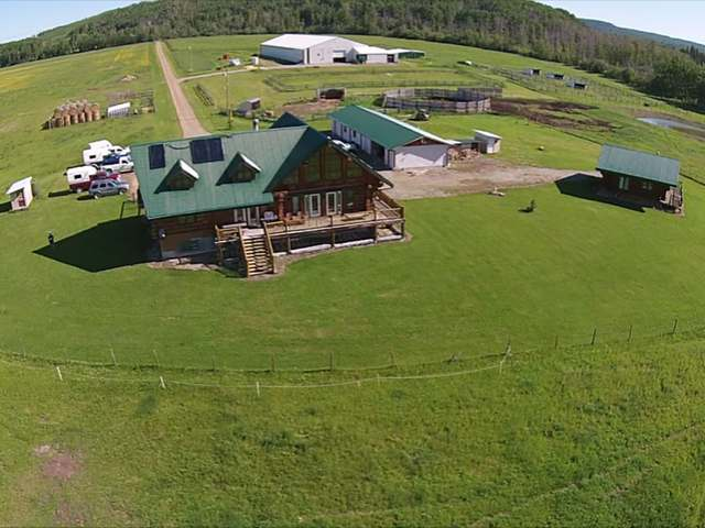 Swan Lake Horse Ranch > Dawson Creek | Custom Lakefront Log Home | 210'x 80′ Indoor Riding Arena | 40×80 Heated Barn | Log Guest House