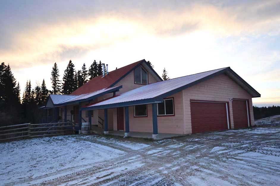 2836 Big Lake Road > Big Lake, BC | 80 Acres | Creek View | Custom Home | 24×36 Barn | Historic Log Cabin